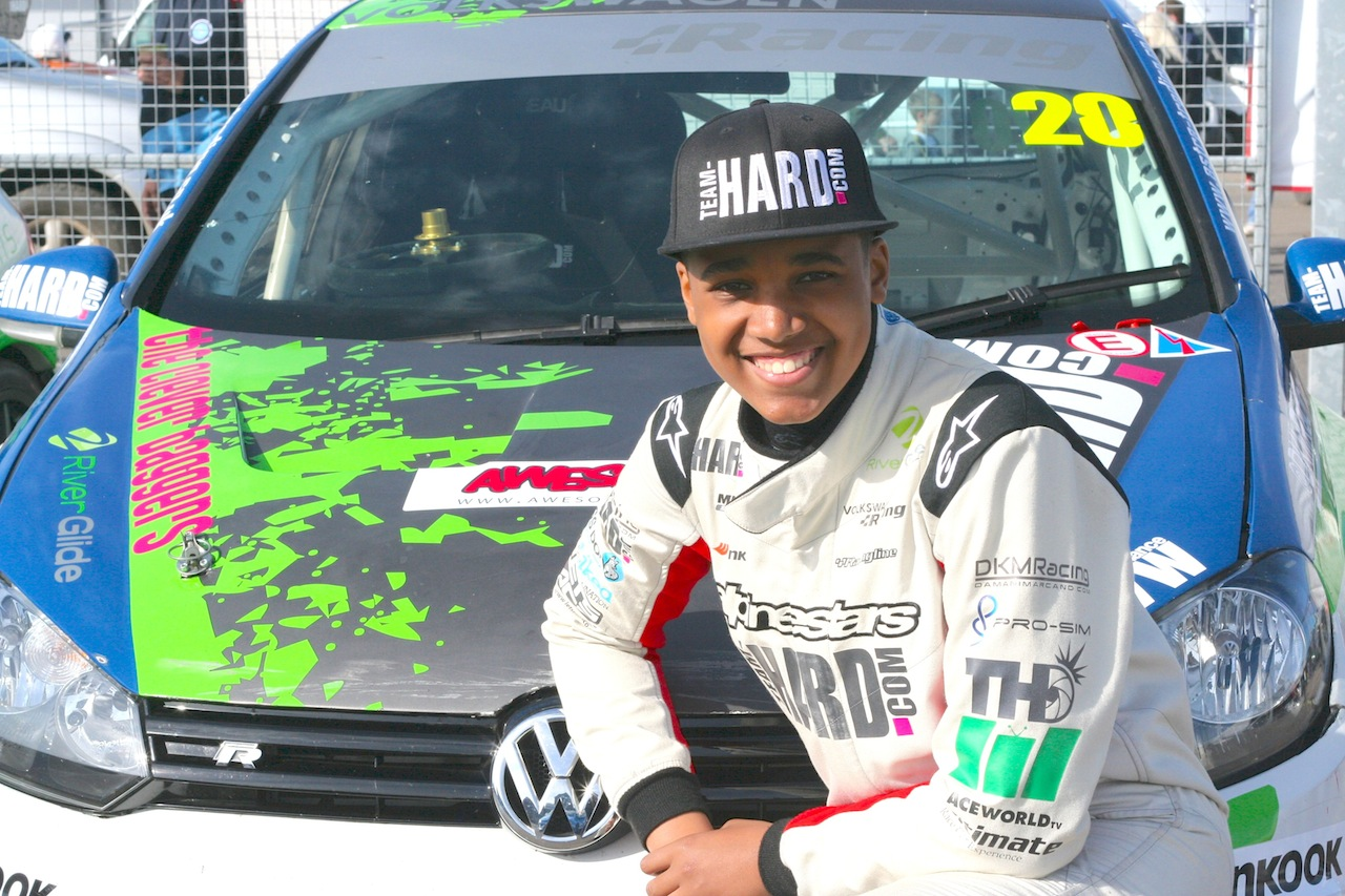 damani-marcano-donington-smiling-in-front-of-car-medium